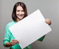 Young brunette woman holding blank sign Royalty Free Stock Photography