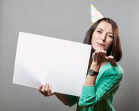 Young brunette woman holding blank sign Stock Images