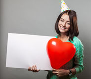 Young brunette woman holding blank sign Stock Image
