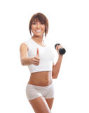 A young brunette woman holding a dumbbell Royalty Free Stock Images