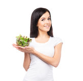 Young brunette woman holding a fresh salad Stock Photography