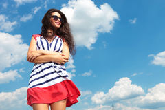 Young brunette woman holding her hands crossed Royalty Free Stock Photo