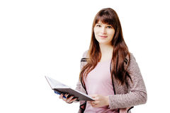 Young brunette woman holding a notebook and pen on white isolated background Royalty Free Stock Photo