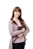 Young brunette woman holding a notebook and pen on white isolated background Stock Photography