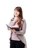 Young brunette woman holding a notebook and pen on white isolated background Stock Photos