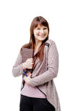 Young brunette woman holding a notebook and pen on white isolated background Royalty Free Stock Photography