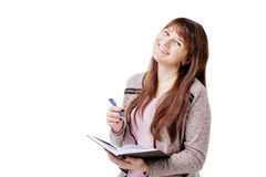 Young brunette woman holding a notebook and pen on white isolated background Stock Image