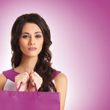 A young brunette woman holding a shopping bag Stock Photos