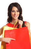 A young brunette woman holding shopping bags Stock Image