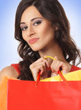 A young brunette woman holding shopping bags Stock Photo