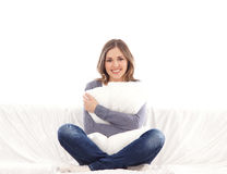 A young brunette woman holding a white pillow Stock Photos