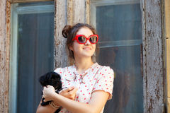 Young brunette woman hugging her lap dog puppy Royalty Free Stock Image