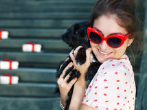 Young brunette woman hugging her lap dog puppy Royalty Free Stock Photo
