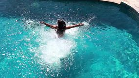 Young brunette woman Jumping in swimming pool. Top of view. 1920x1080 stock footage