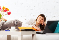Young brunette woman with laptop Royalty Free Stock Photo