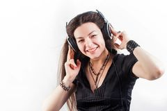 Young brunette woman in large headphones listening to music and having fun. stock image