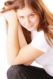 Young brunette woman leaning on hands Stock Image