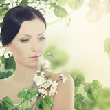 Young brunette woman with leaves Royalty Free Stock Photos