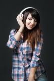 Young brunette woman listening music Royalty Free Stock Photo