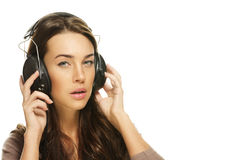 Young brunette woman listening to music Royalty Free Stock Photography
