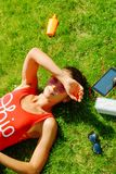 happy young brunette woman listening to the music outdoor on a summer day stock images
