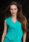 Young brunette woman with long flying hair Royalty Free Stock Photos