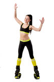 Young brunette woman with long hair training in a kangoo jumps s Stock Photography