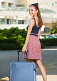 Young brunette woman with luggage. Royalty Free Stock Image