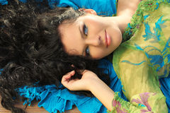 Young brunette woman lying Stock Photo