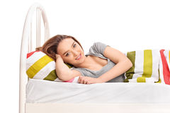 Young brunette woman lying in a bed Royalty Free Stock Image