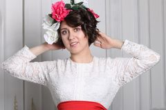 Young brunette woman with make-up and flower wreath stock photo