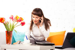 Young brunette woman making a call Royalty Free Stock Image