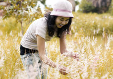 Young brunette woman on the meadow Royalty Free Stock Photos