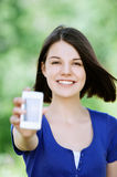 Young brunette woman with mobile Royalty Free Stock Photography
