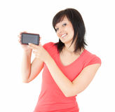 Young brunette woman with mobile phone Stock Images