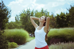 Young brunette woman in nature. Young brunette woman at summer day Stock Photos