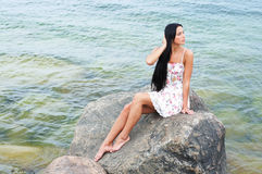 A young brunette woman near the sea Royalty Free Stock Image