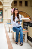 Young brunette woman with a notebook Stock Images