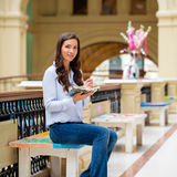 Young brunette woman with a notebook Stock Photography