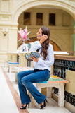 Young brunette woman with a notebook Royalty Free Stock Image
