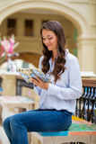 Young brunette woman with a notebook Stock Image