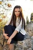 Young brunette woman, outdoors portrait Stock Photos