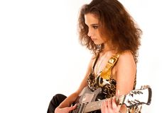 A young brunette woman playing an electric guitar Stock Photography