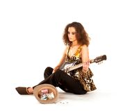 A young brunette woman playing on the guitar Royalty Free Stock Photos