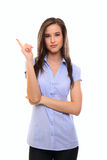 Young Brunette Woman Pointing At Copyspace Royalty Free Stock Photography