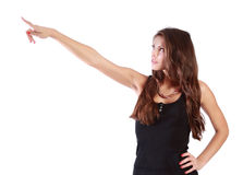 Young brunette woman points by finger away Stock Photo