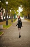 Young brunette woman portrait in autumn color Royalty Free Stock Image