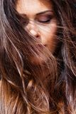 Young woman portrait wind in hair eyes closed outdoor closeup sunny stock photo