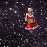 A young brunette woman posing in a Santa dress Stock Photo