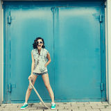 Young brunette woman posing with skateboard Royalty Free Stock Image